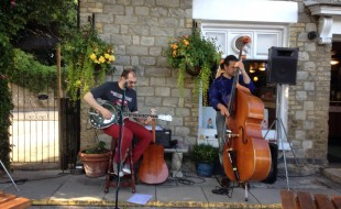 Roots Club artist, Mani Fizzotti, playing in our garden on Sunday 22nd June